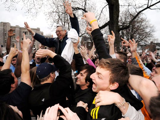 Butler President Bobby Fong celebrates with students after Butler defeated Kansas State to make it to the Final Four.