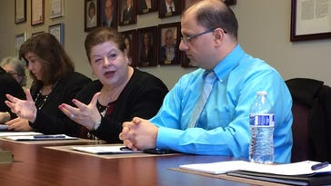 From left, Nida Samona, vice president of operations for the Arab American and Chaldean Council, and Zafer Obeid, right, a physician at the council's Community Health Center, listen as the council's president and CEO, Haifa Fakhouri discusses ways organizations that serve refugees can work together to better serve exiles.