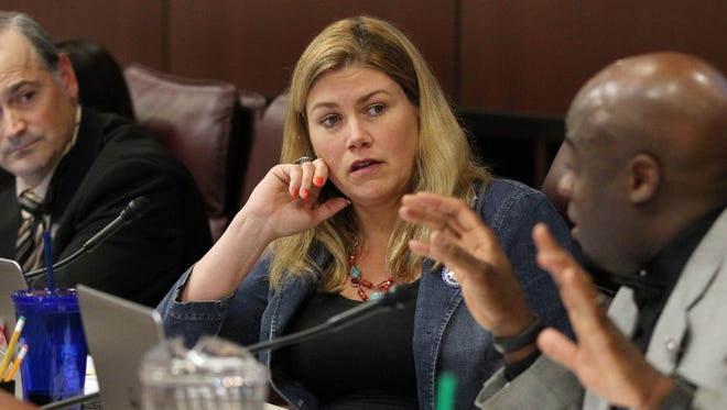 Patricia Farley, R-Las Vegas, center, is shown at the Legislative Building in Carson City in this file photo from 2015.