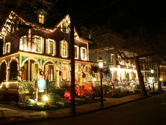 Cape May lights up for Christmas, and visitors can see the decorated homes and inns on nighttime tours.