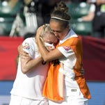 England's Josanne Potter, right, consoles Laura Bassett (6) after Bassett's own goal sent Japan to a 2-1 win over England in the Women's World Cup semifinal.