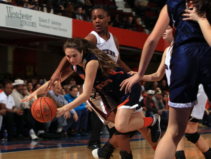 Greeley's Anna Waterhouse (4) tries to get around Ossining's Jalay Knowles (33) during the Class AA girls basketball semifinal game at the Westchester County Center in White Plains Feb. 27, 2014. Ossining won the game 73-47.