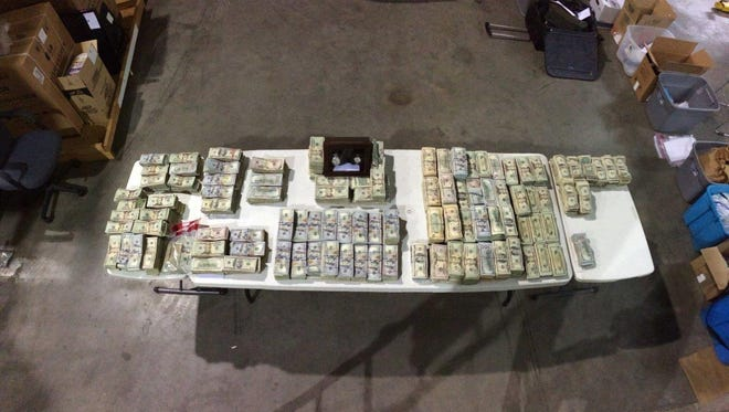 Counted cash seized in Thursday's major cocaine bust by Metro Police narcotics detectives.