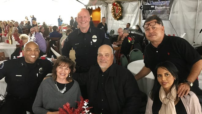 L-R:  Cathedral City Police Deputy Chief Travis, Julie Henry, Cathedral City Police Chief George Crum, Cathedral City Mayor Stan Henry, Julian Jaimes and Albina Jaimes (parents of Club member) all enjoyed the Holiday Gift and Wreath Extravaganza at Bontá Restaurant.