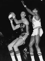 Rick Barry, playing in his first ABA game, prepares