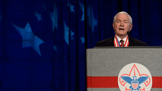 Boy Scouts of America President Robert Gates addresses the group's annual meeting in Nashville May 23, 2014. Gates has said the BSA's longstanding ban on participation by openly gay adults was no longer sustainable.