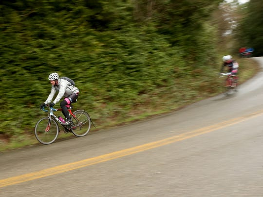 Cyclists zoom down Arrow Point Drive NE during Cascade