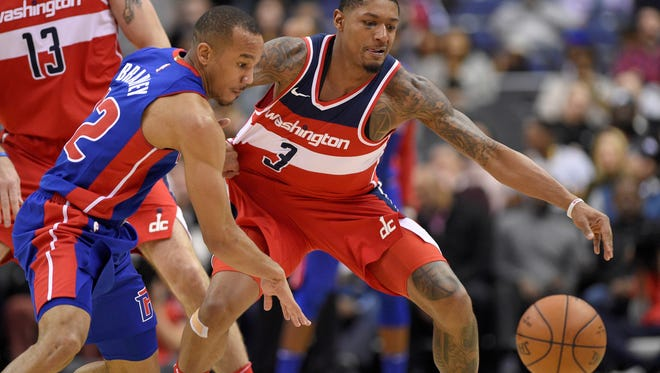 Detroit Pistons guard Avery Bradley (22) works for the ball against Washington Wizards guard Bradley Beal (3) during the first half of an NBA basketball game, Friday, Dec. 1, 2017, in Washington.