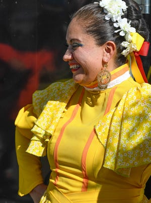 Ana Cisneros watches dancers on stage as she wears a traditional costume from Durango Mexico during the Fiesta Evansville 2016 held at Wesselman Park Sunday. The event celebrates Hispanic heritage with food booths, music, dance and a multicultural parade, October 9, 2016.