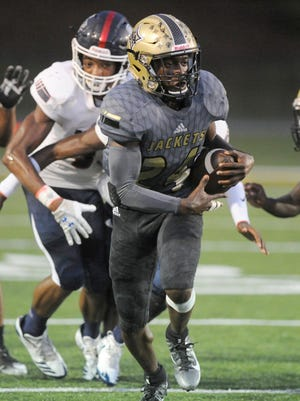 North Augusta HIgh running back DeJuan Bell (24) is among the 10 players to sign with Furman during college football's early signing period this week.