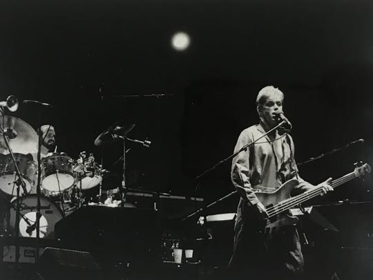 Peter Cetera, right, performs with Chicago at the Indianapolis Tennis Center in 1983.
