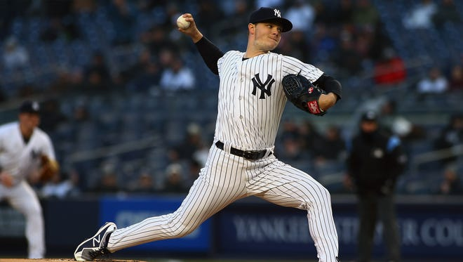 Apr 20, 2018; Bronx, NY, USA; New York Yankees starting pitcher Sonny Gray (55) pitches against the Toronto Blue Jays during the first inning at Yankee Stadium.