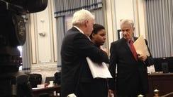 De'asia Watkins standing between her attorneys, Norm
