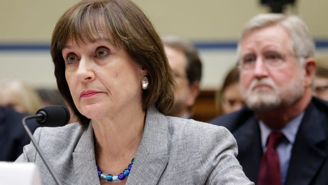 Lois Lerner listens to questions with her lawyer William W. Taylor III, right, before invoking her 5th amendment right not to testify during hearing about IRS targeting of Tea Party groups.