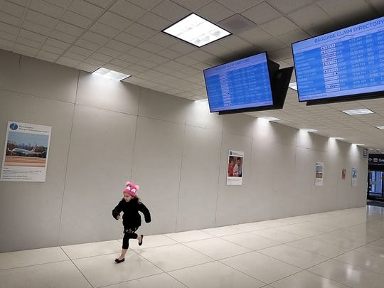 Carson Cronk of Tampa, Florida plays around a safety wall blocking conveyor belts under construction in the baggage claim area at the Memphis International Airport. Preparations for a $214 million modernization of 55-year-old B Concourse have accelerated in recent weeks as airport officials move gates, concessions and amenities to temporarily serve all passengers in A and C concourses.