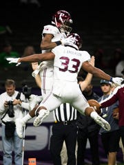 Troy wide receiver Damion Willis (15) celebrates with