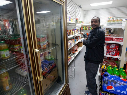 Ahmed Ahmed, owner of Hamilton Market in Northside,