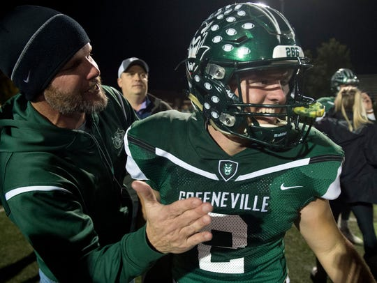 Greeneville quarterback Cade Ballard is congratulated
