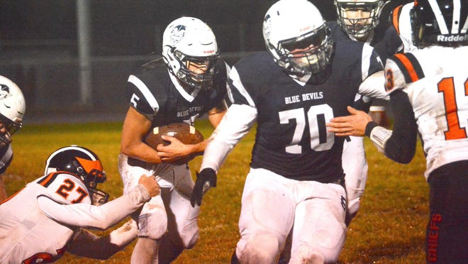 Sault High lineman Adam Horrigan (70) leads the way for running back John Robinson (5) during last week's game against Cheboygan. The Blue Devils open the playoffs with a home game Saturday against Saginaw Arthur Hill.