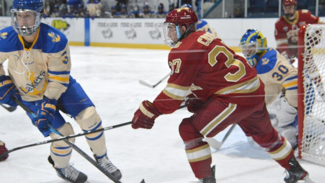 Lake Superior State's Will Riedell (3) and Mareks Mitens (30) defend against Denver in a game last season. The Lakers are scheduled to open the 2020-21 season at home against Michigan Tech this Saturday and Sunday at Taffy Abel Arena.