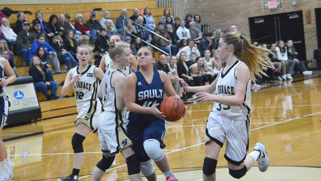 Sault High's Lilly Alaspa tries to drive into the lane between Emmalee Hart and Ally Schultz of St. Ignace during a Straits Area Conference girls basketball game. The Sault and St. Ignace are currently scheduled to open the 2020-21 season in early January.