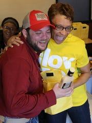 Jonathan Dycus is congratulated by Deborah Harrison after winning a bottle of the special sauce. Harrison is an account executive with Walker & Associates, the advertising agency for Memphis-area restaurants.