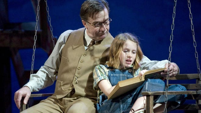 """Lee E. Ernst and Mallorey Wallace in the Milwaukee Repertory Theater's 2012 production of """"To Kill a Mockingbird."""" Last month, Accomack County, Va., public schools temporarily pulled """"To Kill a Mockingbird"""" and """"The Adventures of Huckleberry Finn"""" from classrooms and libraries because a parent complained about the racial slurs they contain."""