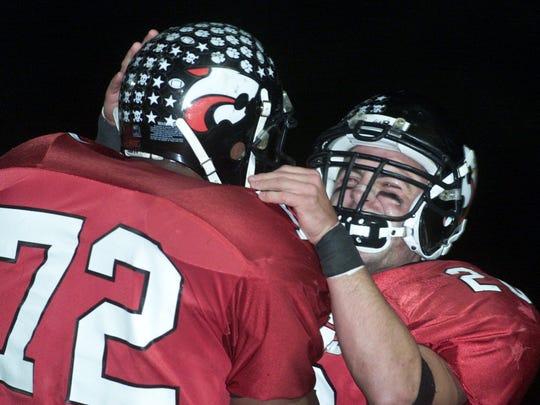 Jackson's Ray Brown (72) and Joe Serratelli celebrate a touchdown during the 2001 season.