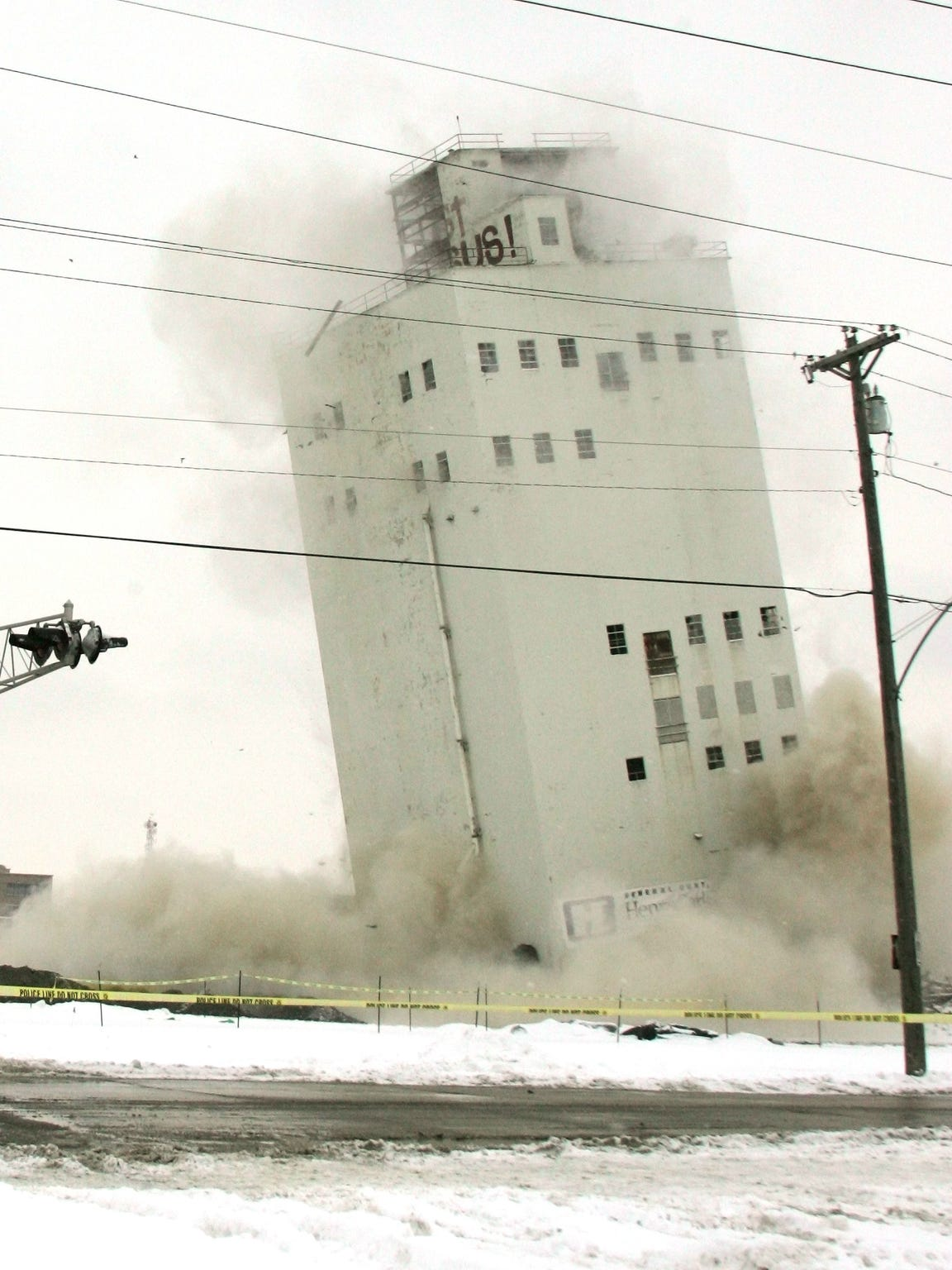 The Zip Feed Tower falls about 25 feet December 3,