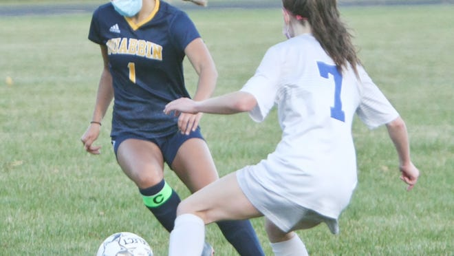 Quabbin senior Riley Rischitelli makes a move to get around Narragansett's Ashley Kilbury (7) during Wednesday evening's game at Alumni Field in Barre. Rischitelli, who has scored seven goals through the Panthers' first three games, recorded a hat trick in Quabbin's 5-0 win.