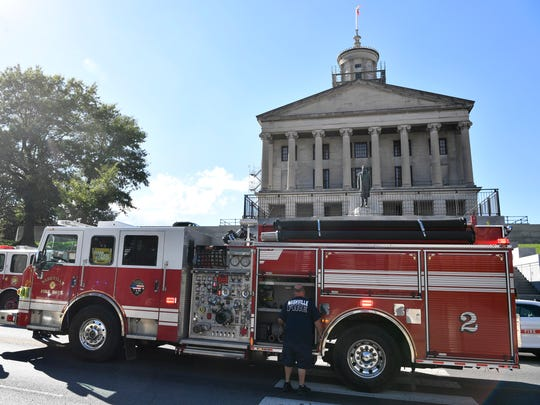 Metro Nashville firefighters work a fire at the Tennessee State Capitol after it was evacuated late Monday afternoon,