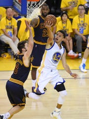 Jun 14, 2015; Oakland, CA, USA; Golden State Warriors guard Stephen Curry (30) shoots the ball gainst Cleveland Cavaliers guard Matthew Dellavedova (8) in game five of the NBA Finals at Oracle Arena. Mandatory Credit: Bob Donnan-USA TODAY Sports