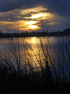 Sunset over Braddock Bay, 2007. The bay is part of a large wetlands complex on the Lake Ontario shoreline in Monroe County.