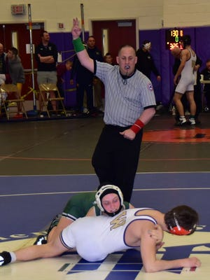 Mia Macaluso (green singlet) of Minisink Valley competes in the Section 9 wrestling tournament.