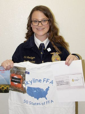 Cali Newdigger, a Skyline FFA member, holds some of the items she is sending to FFA members in all 50 states, Puerto Rico and the Virgin Islands as part of the fulfillment of her required Supervised Agriculture Experience project in FFA.