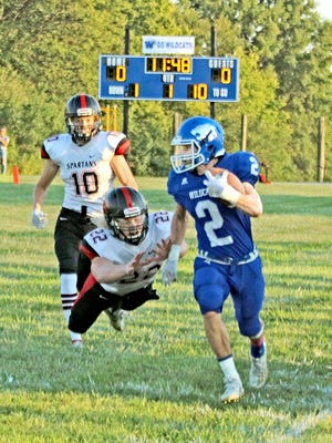 On the game's first offensive play, Southwest Livingston Wildcats senior receiver Chase Neptune, having caught a crossing-route pass, outruns a diving South Holt/Nodaway-Holt Spartan defender's diving tackle attempt along the west sideline on his way to a 53-yards pickup. The Wildcats scored the contest's first touchdown a few plays later and, with a blazing start and dominant finish, advanced their record to 2-0 with a 70-36 Highway 275 Conference triumph in their 2020 home opener Friday, Sept. 4.