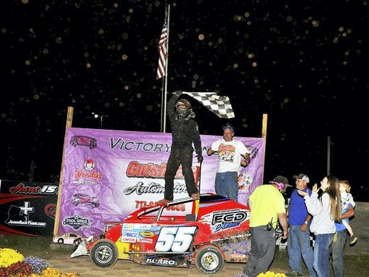 Annville's Michael Burrows celebrates with his family and friends after his biggest win in the Modified 50 at Linda's Speedway.