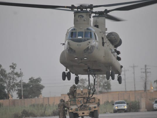 Aviation units, Task Force Strike Soldiers refine sling load skills