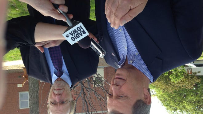 Reps. Tom Latham, left, and Dave Loebsack speak to reporters at the Des Moines Veterans Affairs Medical Center Friday, May 23.