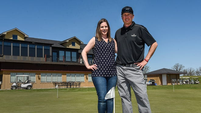 Jess and Dan Stang are the new owners of the Territory Golf Club. They are shown Monday, May 7, outside the clubhouse in St. Cloud.