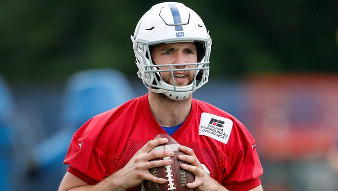 Indianapolis Colts quarterback Andrew Luck (12) throws a football, a Wilson TDS 1205 High School size football, in front of the media during their Colts minicamp at the Indianapolis Colts complex on Tuesday, June 12, 2018.