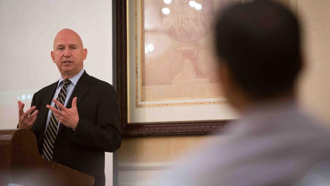 Gov. Jack Markell announces a new homeowner assistance program in Newark on Tuesday. Business groups are pressuring Markell and state leaders to gain greater control of Delaware's budget.