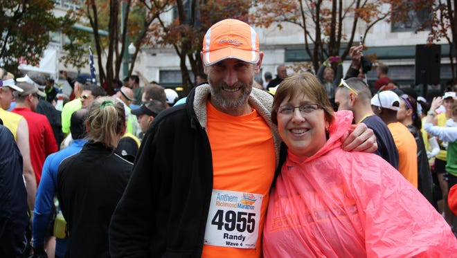 Wisconsin's Randy Zemlicka, left, and his late wife, Mary Kay Zemlicka pose for a photo during the Richmond Marathon. Randy Zemlicka is running in the Vermont City Marathon, his first marathon since Mary Kay died following a car crash in California in March.