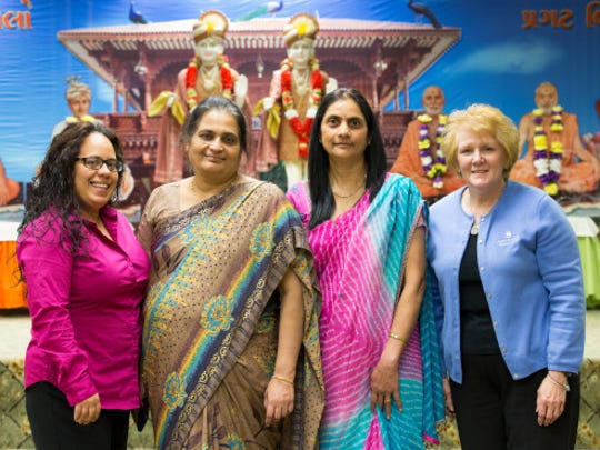 Christiana Care outreach navigator Joceline Valentin, Anjana Pandya, Chhaya Patel and Nora Katurakes, MSN, RN, OCN, Cancer Outreach and Education manager on a recent Sunday at the temple.