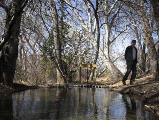 Jon Radtke (Coca-Cola's hydrogeologist) walks along