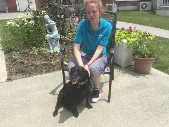 Longview resident aide Liz Rendenback with her dog,