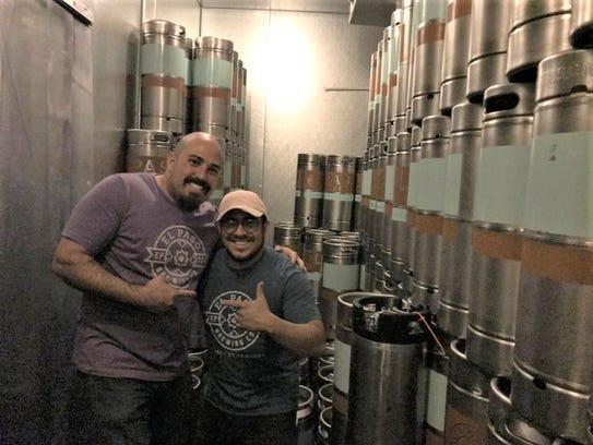El Paso Brewing Co. co-owner Carlos Guzman, and assistant