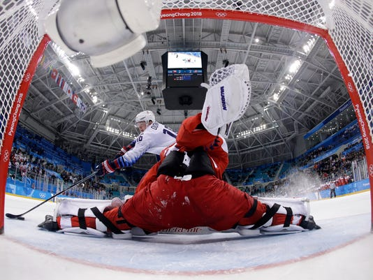 Goalie Pavel Francouz (33), of the Czech Republic, blocks a shot by Ryan Donato (16), of the United States, in the penalty shootout in the quarterfinal round of the men's hockey game at the 2018 Winter Olympics in Gangneung, South Korea, Wednesday, Feb. 21, 2018. The Czech Republic won 3-2. (AP Photo/Matt Slocum, Pool)