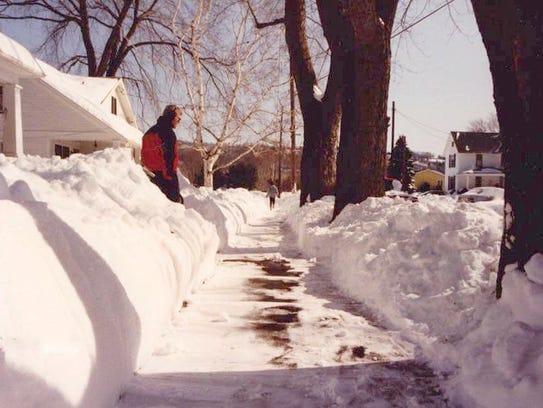 Tom Janowski surveys the sidewalk that he just finished
