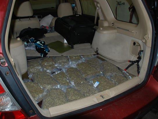 Police say they seized 290 pounds of marijuana in total